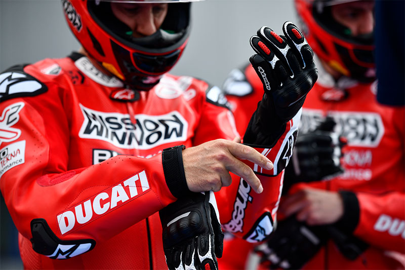 Ducati rider putting on gloves